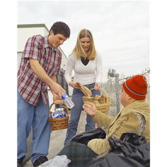Man and Woman helping Homeless Man